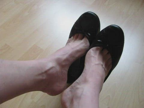 well worn black leather sabrinas, pink polished toes - shoeplay and dangling