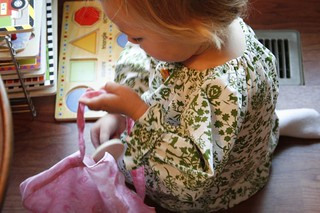 before school, loading her purse with puzzle pieces | by pinkpicketfence