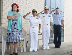 U.S. Ambassador to the Federated States of Micronesia (left), Doria Rosen, U.S. Defense Representative to the Federated States of Micronesia, Rear Adm. Bette Bolivar, Commodore, Task Force Forager, Capt. James Meyer, and New Zealand Air Force Chaplain Ken Diekema, stand for the playing of the U.S. national anthem during an opening ceremony June 22.