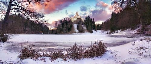 landscape trakoscan croatia lake sunset winter snow clouds sky panorama landmark frozen outdoor cold castle building