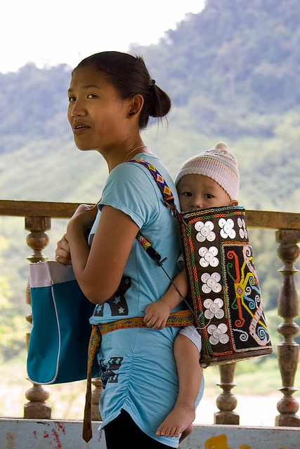 Kayan Or Kenyah Woman With Baby In Traditional Carrier