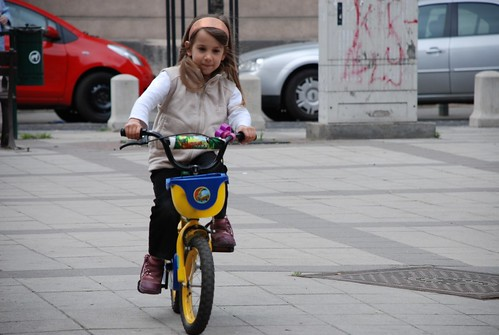 Little girl with bicycle | by ckaroli