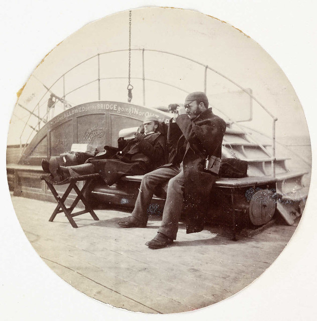 Two men on the deck of a ship