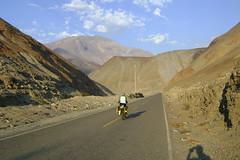 Nancy riding on the desert road near Chuquicara
