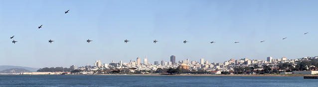 14 Blue angels split and roll above city