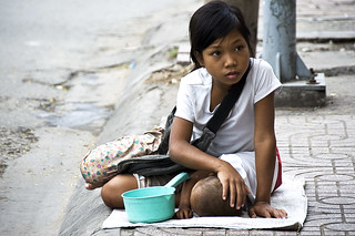 Saigon - A street girl and her baby sister begging by the road side | by Mio Cade