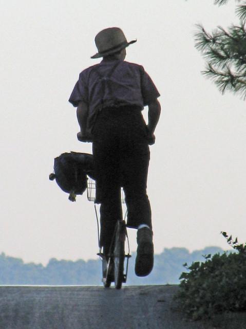 Amish Boy Biking Up a Hill