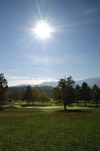 trees sun mountains color grass sunrise lawn golfcourse