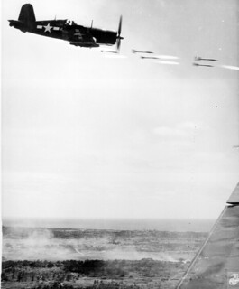Corsair fighter looses its load of rocket projectiles