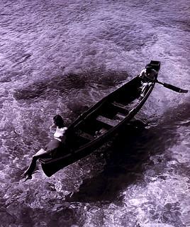 Toni Frissell: Fashion model on edge of boat, Montego Bay, Jamaica, 1946
