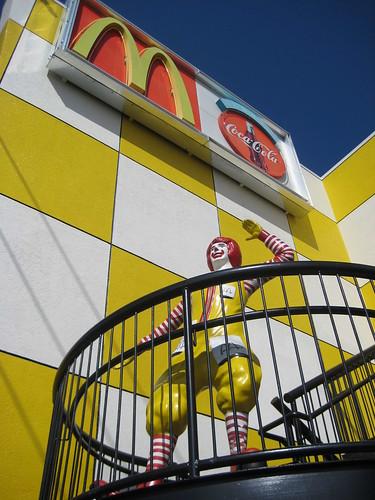 Ronald McDonald waving to passing traffic