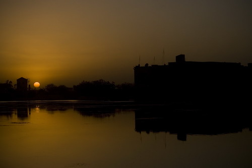 sunset sun water silhouette contrast buildings dark desert iraq