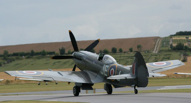 Griffon Spitfire taxing to Duxford's runway