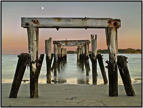 ocean moon water pier twilight sand massachusetts northshore beverly pilings beverlyfarms westbeach blueribbonwinner olympuse500 flickrsbest diamondclassphotographer goldstaraward qualitypixels globalworldawards oldnikkor28mmf28