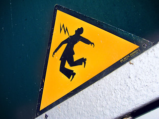 Danger Electric Shock Risk. Sign | by Tomás Fano