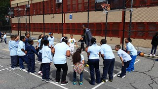 WITS Coach Rob Sanders leading students in a fun and interactive game on the recess yard | by USDAgov