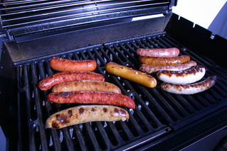 a grill full of sausage | by pkingDesign