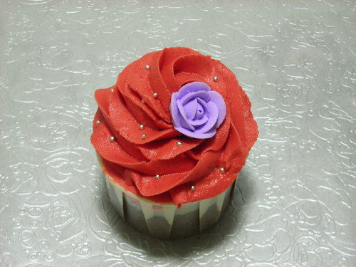 single purple rose on red cupcake swirl | Lydia's Sweet ...