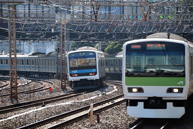 Yamanote Line Train and Keihin-tohoku Line Train near Tamachi Station