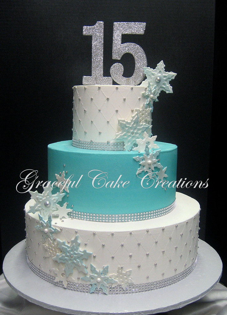 e7e65b46961 ... Elegant White and Tiffany Blue Quinceanera Cake accented with Siler  Rhinestaon Ribbon and Fondat Snowflakes