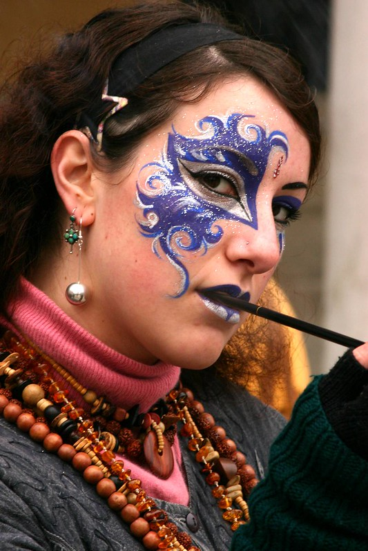 Lovely portrait of a lass with a painted face at the Carnivale in Venice