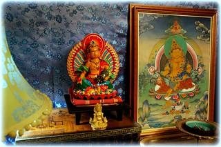 Dzambhala, two statues, and painting with traditional Dzam