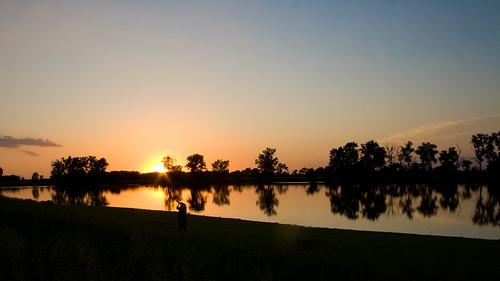 sunset reflections withthecamera desotobendnationalwildliferefuge aneagleflewoverhead andlandedinanearbytree butthesunsihouettedhim sopauldecided tojumpthefence togetabettershot ifyoulookrealclose youcanseehim