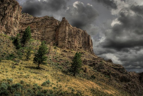 cloud storm tree rock wall dark day moody ominous canyon wyoming cody