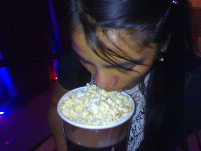 eating popcorn  without hands