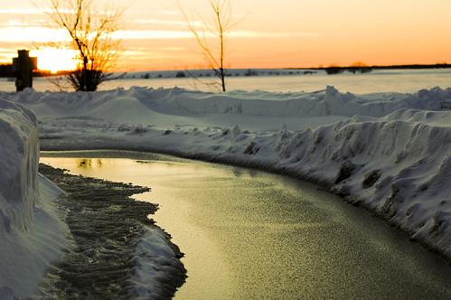 sunset snow water melt
