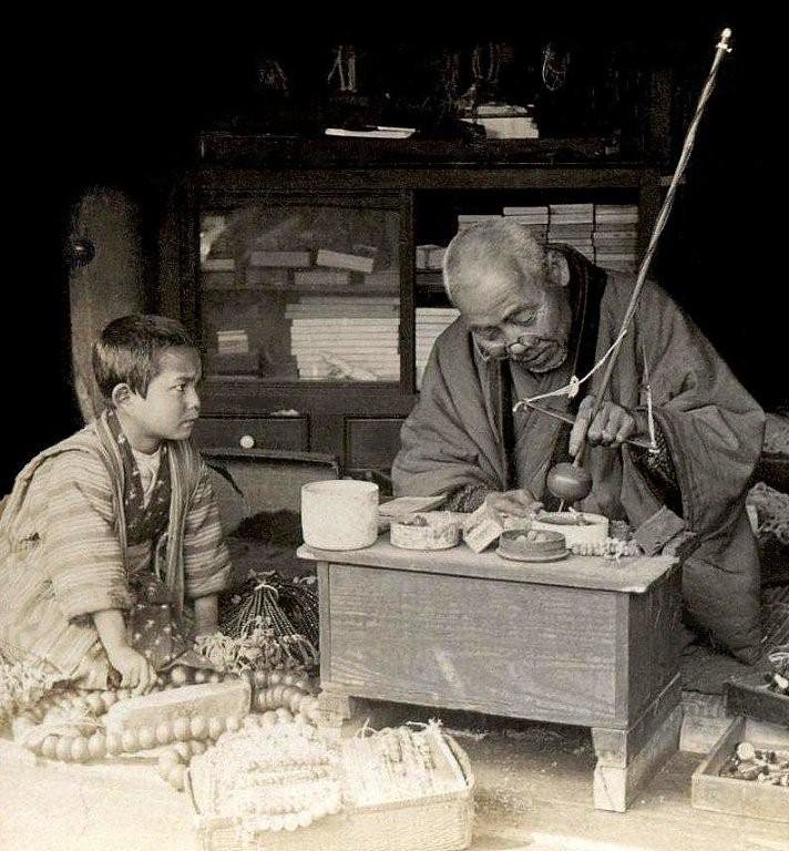 THE BEAD MAKER --  Apprentice Watches the Master -- A Rosary Shop in Old Meiji-Era Japan