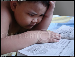 Young Boy reading a book | Young boy studying | | by ROMMEL BANGIT