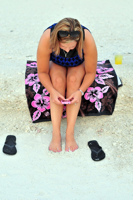 Kim.  iPhone.  Painted toes.  Sand.