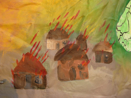 Burning village painting at encampment for Darfur | by futureatlas.com