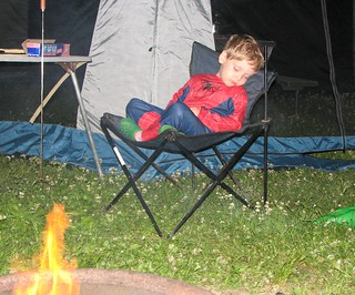 Jordan Snoozing by the Campfire
