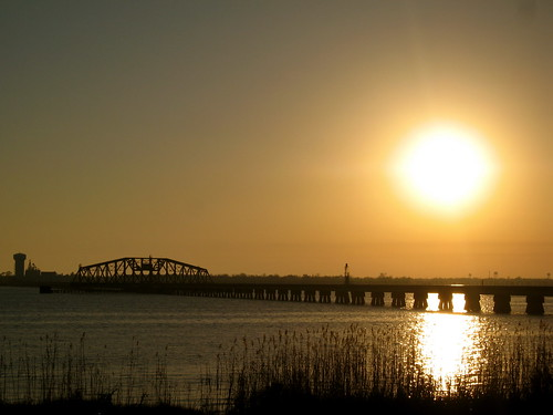 ocean bridge sunset orange reflection water train river reeds mississippi golden melting unitedstates hues inlet biloxi tones fiery