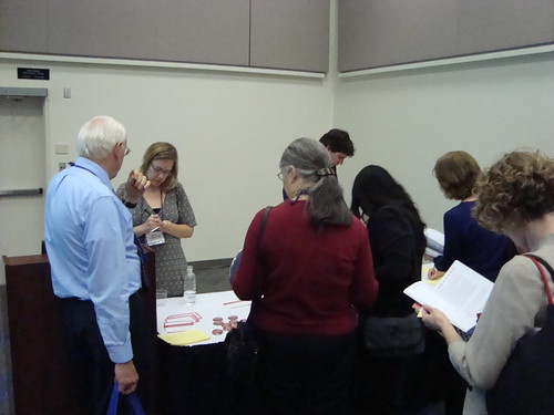 attendees of MaintainIT Book Club presentation crowding around Brenda Hough
