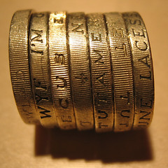 Pound coins in a row | by iainr