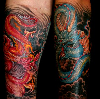 Dragons fighting - tattoo by Donald Purvis | by donaldpurvis