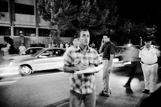 Police informer writing down the protestors' chants مخبر يكتب هتافات المتظاهرين