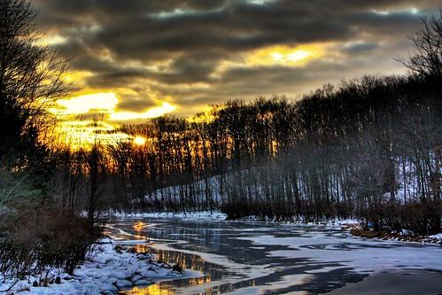 trees sunset usa sun snow ice clouds unitedstates pennsylvania northamerica northeast pikecounty scoreme48 goldkeylake northeasternunitedstates delawareriverwatershed dingmantownship goldkeylakeestates