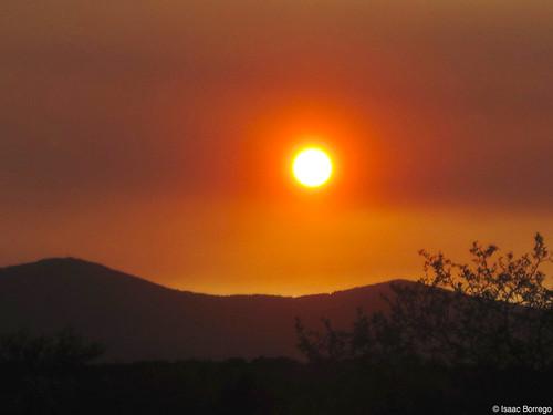sun sunset settingsun light mountains silhouette newmexico nm whiterock losalamos fire red smoke haze june 2011 canon eos rebel xsi unitedstates america usa