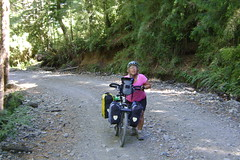 Nancy pushing her bike up to the Chilean border at Paso V. Peres Rosales