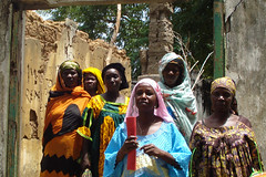 Central African women inspecting building for microfinance project | by hdptcar