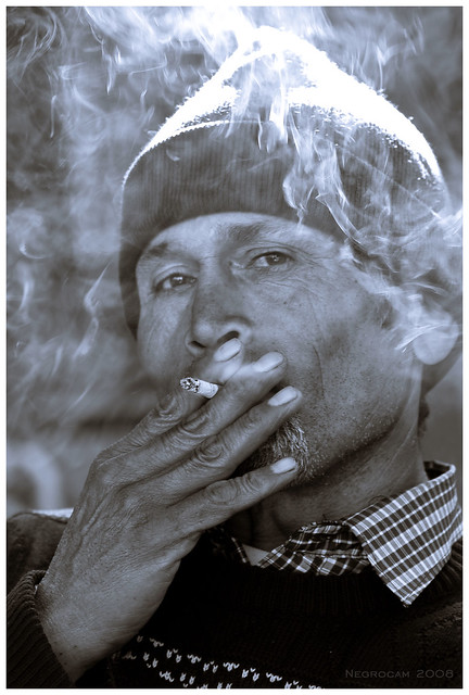 Fumando....