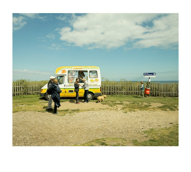 Tourists, ice cream van, fence, sea and sky