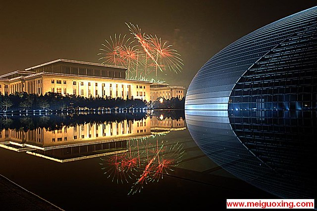 Fireworks above National Grand Theatre and Great Wall of the People