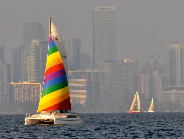 Sailboats & Bright Colored Catamaran Lit Up By Falling Sun Against Hazy Florida Weather Fogging Miami Skyline - IMRAN™ — 35,000+ Views!