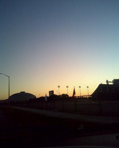 road trees sky building sign sunrise parkinglot louisiana driving lafayette flag sidewalk lamppost incar 365 errands universityoflouisianaatlafayette ullafayette cajundome universityoflouisiana cajunfield
