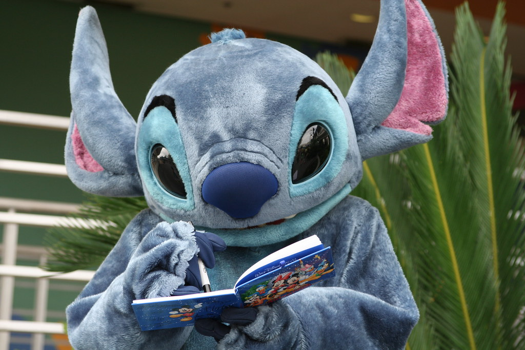 Stitch signing an autograph book